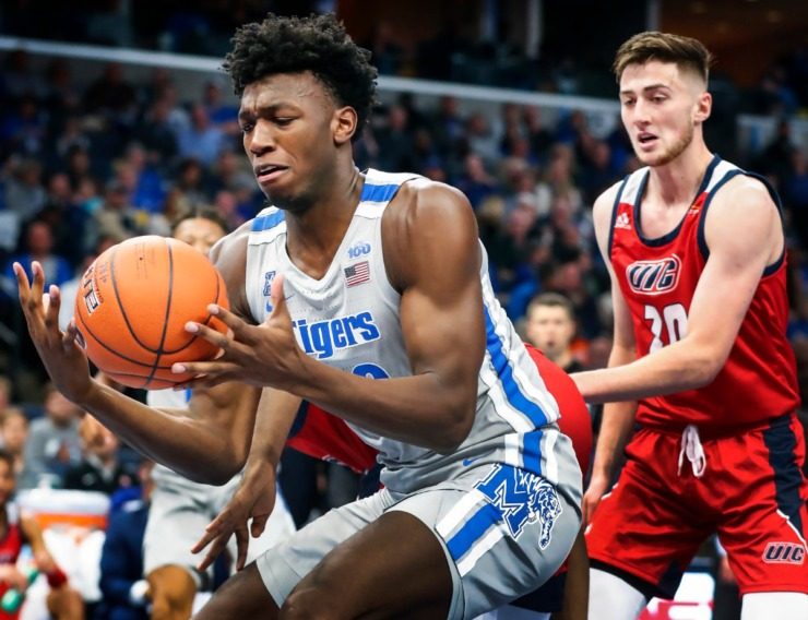 <strong>Memphis center James Wiseman (left) grabs a rebound against the UIC defense during action on Nov. 8, 2019, at FedExForum.</strong> (Mark Weber/Daily Memphian)