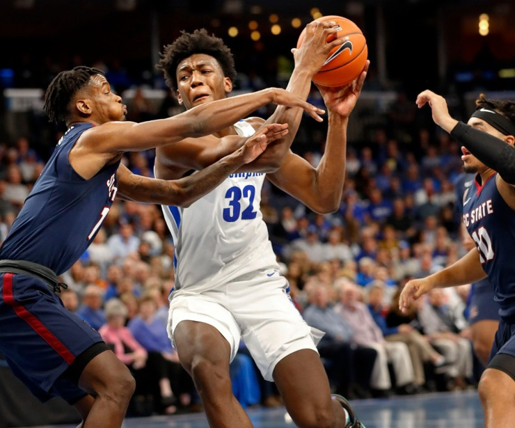 <strong>Memphis center James Wiseman (right) drives the lane against South Carolina State defender Tariq Simmons (left) during action on Nov. 5, 2019, at FedExForum.</strong> (Mark Weber/Daily Memphian)