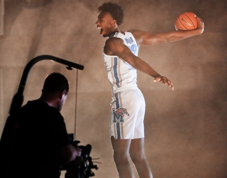 <strong>James Wiseman puts on his best slam-dunk face during a photo session with the University of Memphis basketball team on Oct. 11, 2019 at the Laurie-Walton Family Basketball Center. Tigers team members gathered for the annual team photo and to shoot promo and intro videos for the season.</strong> (Jim Weber/Daily Memphian)