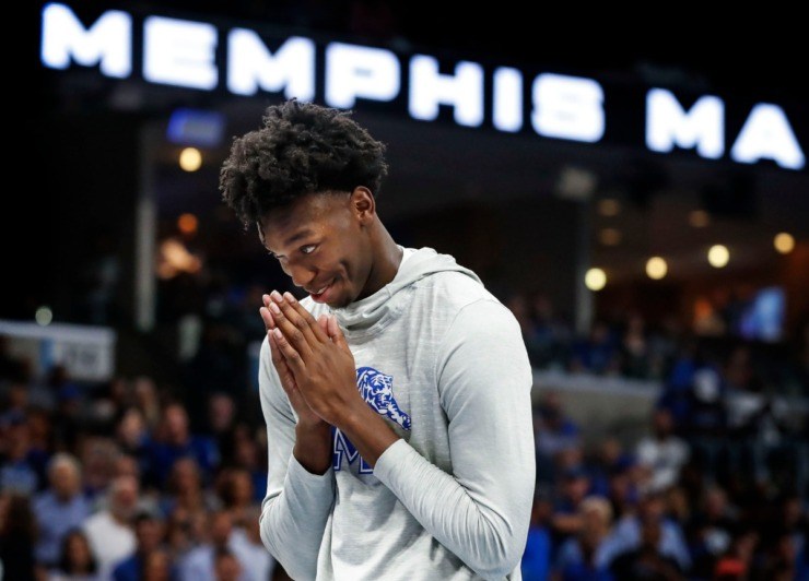 <strong>University of Memphis basketball player James Wiseman prays before teammate Damion Baugh jumps over him during the dunking contest at Memphis Madness at the FedExForum on Oct. 3, 2019.</strong> (Mark Weber/Daily Memphian)