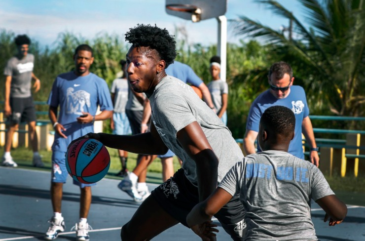 <strong>Memphis Tigers player James Wiseman shows off his dribbling skills during a basketball camp with local youth in the Bozine Town area of Nassau, Bahamas, on August 16, 2019.</strong> (Mark Weber/Daily Memphian)