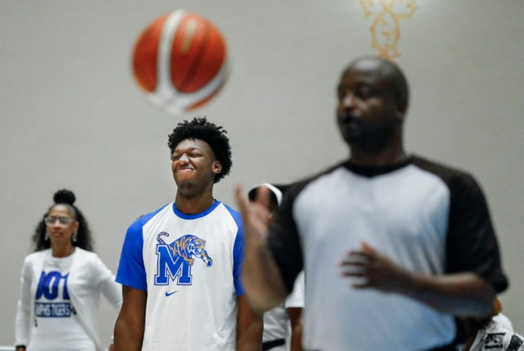 <strong>University of Memphis center James Wiseman (middle) reacts on the bench during action against the Bahamas National Team in their exhibition game in Nassau, Bahamas, on Aug. 17, 2019.</strong> (Mark Weber/Daily Memphian)