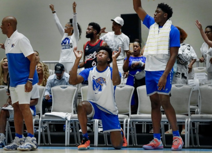 <strong>University of Memphis center James Wiseman (middle) celebrates a made 3-pointer during action against the Bahamas National Team in their exhibition game in Nassau, Bahamas, on Aug. 17, 2019.</strong> (Mark Weber/Daily Memphian)