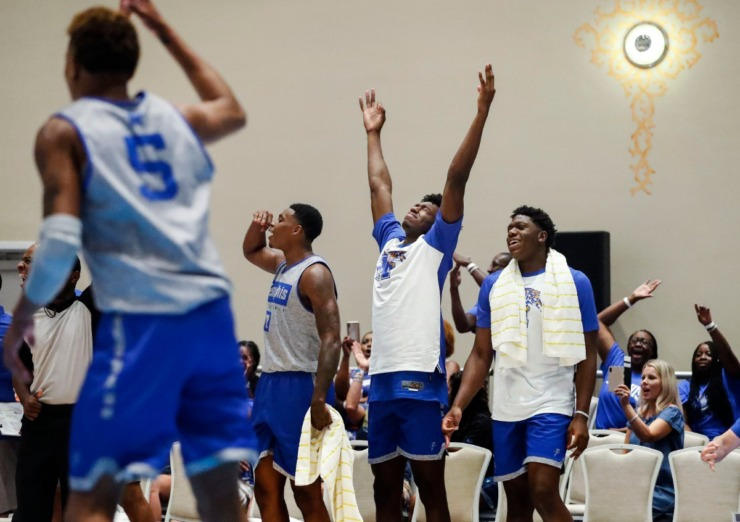 <strong>University of Memphis teammates D.J. Jeffries (from left) James Wiseman and Malcolm Dandridge celebrate a made 3-point shot against Commonwealth Bank Giants during action in their exhibition game in Nassau, Bahamas, on Aug. 14, 2019.</strong> (Mark Weber/Daily Memphian).