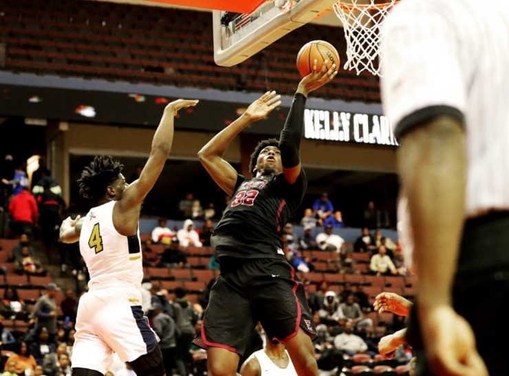 <strong>Center for East High School James Wiseman (32) pulls up for a one-handed jump shot in a game against Olive Branch High School at the Landers Center on Nov. 20, 2018. Wiseman has committed to Penny Hardaway's 2019 recruiting class for the University of Memphis basketball team.</strong> (Houston Cofield/Daily Memphian)