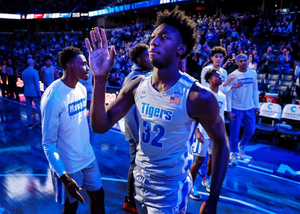 <strong>Memphis center James Wiseman (middle) waves as he is introduced before the UIC game Nov. 8.</strong>&nbsp;<strong>Now he's waving goodbye.</strong> (Mark Weber/Daily Memphian)