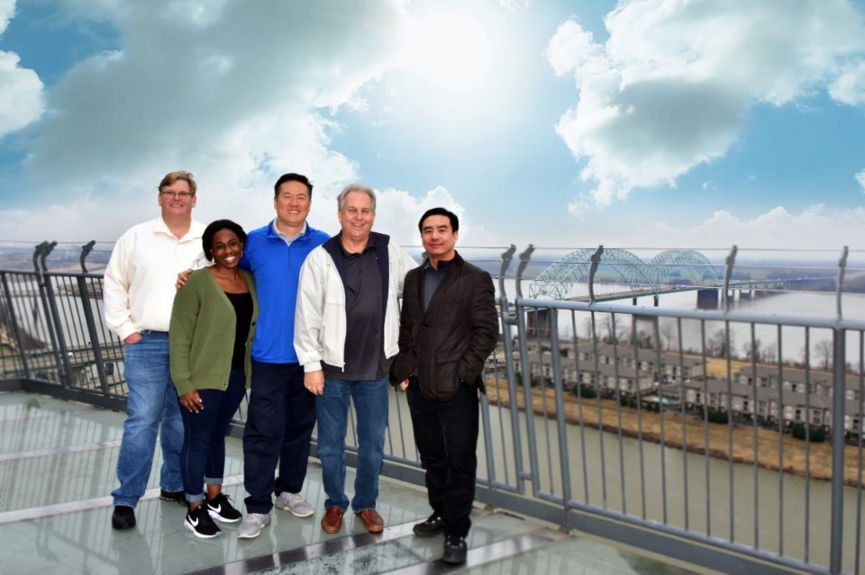 <strong>Wei Chen, middle, is pictured with Sunshine Enterprise co-workers, from left, Mike McAnnally, Danielle Mitchell-Robinson, Bruce Pelynio and John Chen. All but McAnnally died in a plane crash in Atlanta last Dec. 20.</strong> <em>(</em>Submitted photo)