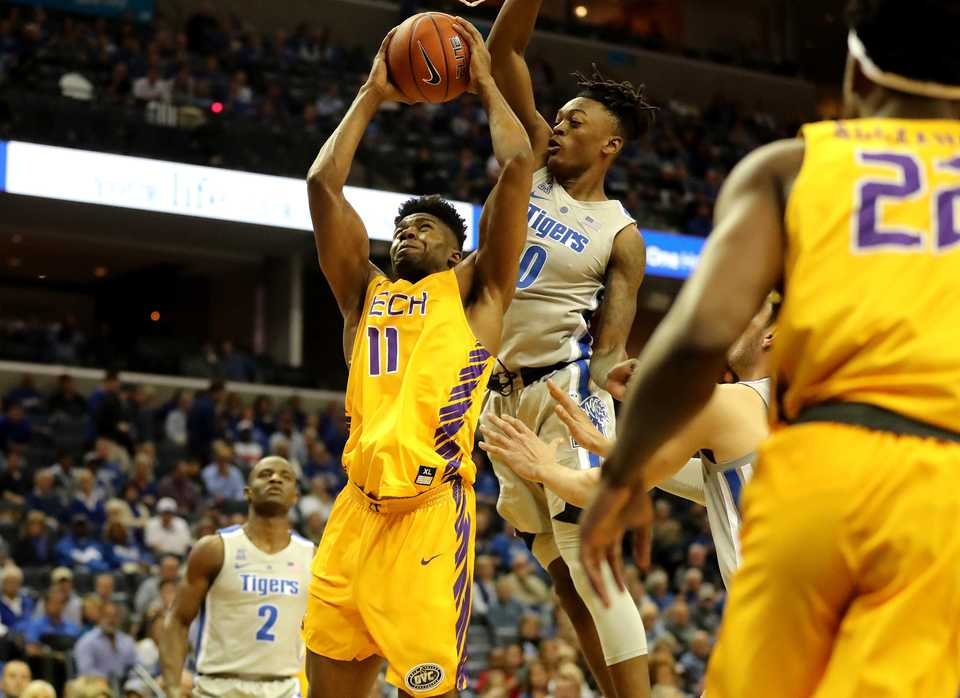<strong>Tennessee Tech center Micaiah Henry (11) drives to the basket against Memphis Tigers' forward Kyvon Davenport (0) in the season opener at FedExForum.</strong> (Houston Cofield/Daily Memphian).