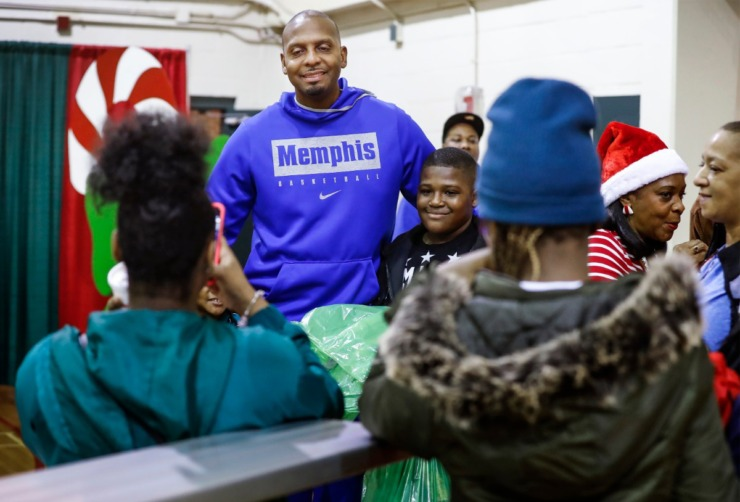 <strong>University of Memphis head basketball coach Penny Hardaway (middle) takes pictures with fans during the Tigers' toy giveaway on Dec. 20, 2019, at the Davis Community Center.</strong> (Mark Weber/Daily Memphian)
