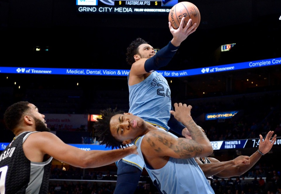 <strong>Memphis Grizzlies guard Dillon Brooks (24) shoots above guard Ja Morant and Sacramento Kings guard Cory Joseph (9) in the first half of an NBA basketball game on Dec. 21, 2019, in Memphis.</strong> (AP Photo/Brandon Dill)