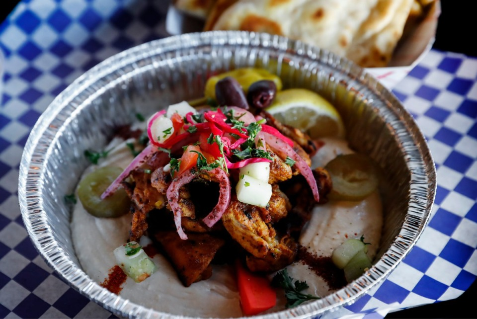 <strong>Happy Greek&nbsp;Caf&eacute;&rsquo;s grilled chicken shawarma comes on a bed of hummus, garnished with olive oil, fresh lemon juice and spices. It's topped with <span>pickles</span>, seasoned onions, chopped salad and served with pita bread.</strong> (Mark Weber/Daily Memphian)