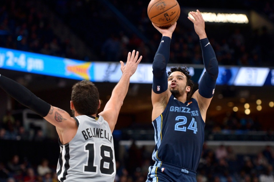 <strong>Memphis Grizzlies guard Dillon Brooks (24) shoots over San Antonio Spurs guard Marco Belinelli (18) during the first half of an NBA basketball game on Dec. 23, 2019, in Memphis.</strong> (AP Photo/Brandon Dill)