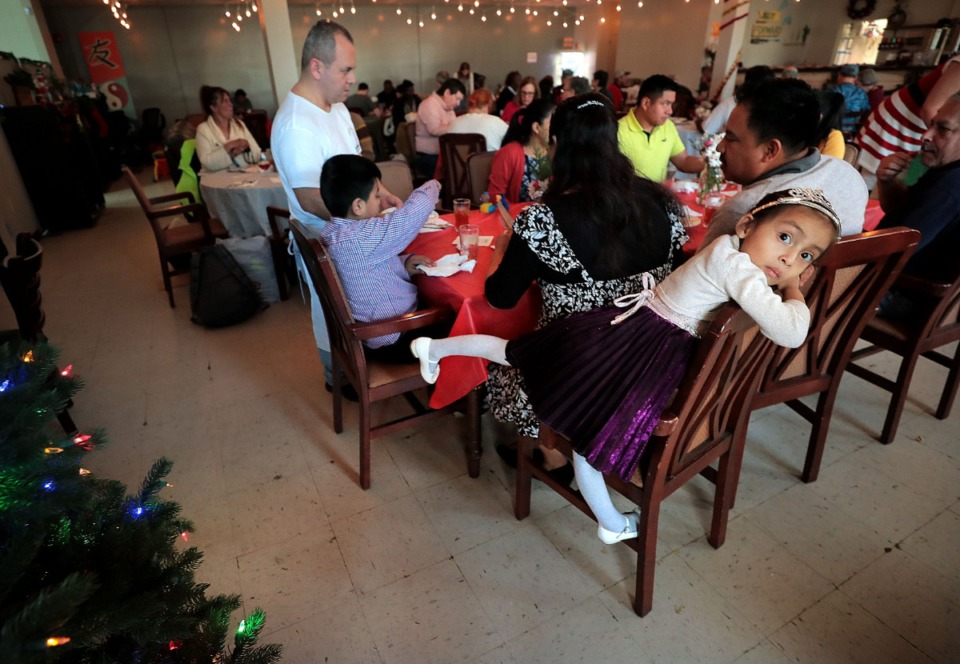 <strong>Odri Xocop, 4, waits between courses during the Caritas Community Center's first Christmas lunch on Dec. 25, 2019. The cafe hosted a three-course Christmas meal for 65 community members who would not otherwise be able to enjoy a holiday meal themselves.</strong> (Jim Weber/Daily Memphian)