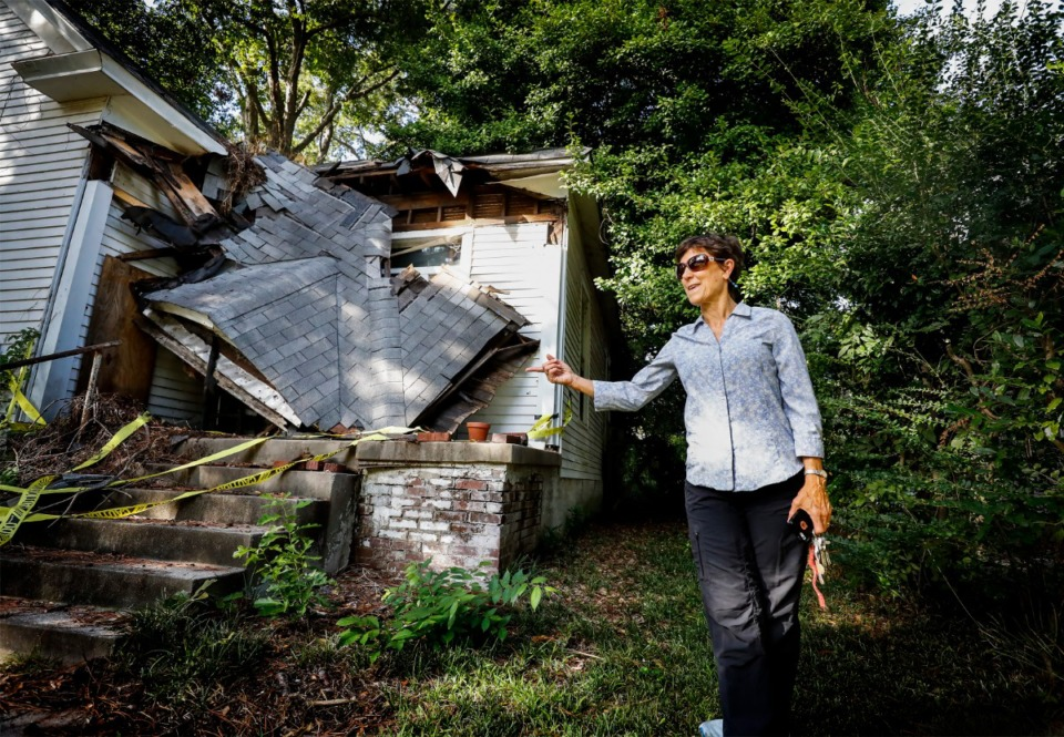 <strong>Joni Laney, president of the Binghampton Community Land Trust, looks over a blighted house on Oxford Avenue on Oct. 9, 2019. The group purchased the home and hopes to demolish it and build a new one in its place, keeping it affordable for potential buyers who will commit to living in the neighborhood.</strong> (Mark Weber/Daily Memphian)