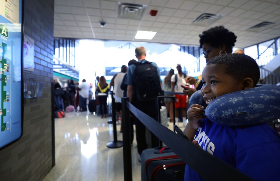 <strong>Kingman Johnson seemed to be interested in a map of the Memphis International Airport on May 24, 2019, while waiting in line with this mother, Christine Neal, to board a flight to Fort Lauderdale, Florida. New nonstop flights&nbsp;<span>are hopeful signs for the airport in 2020, officials say.&nbsp;</span></strong>(Patrick Lantrip/Daily Memphian file)