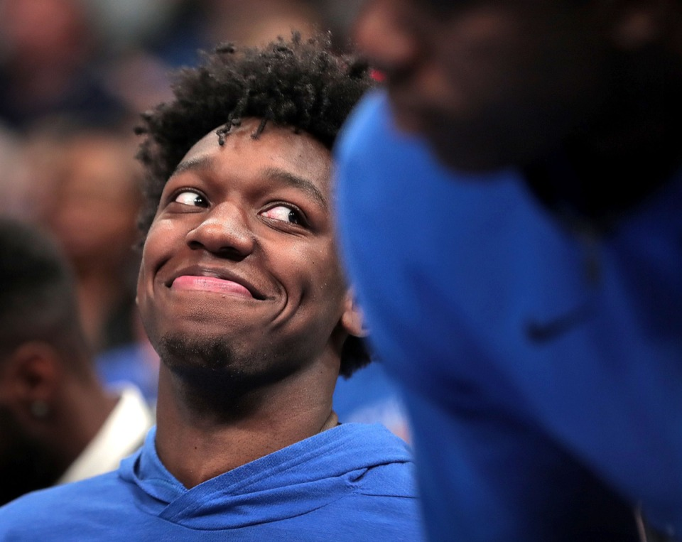 <strong>University of Memphis center James Wiseman jokes with teammates Nov. 23 at FedExForum. Some hold out hope the big man could return, but it doesn't seem likely.</strong> (Jim Weber/Daily Memphian)