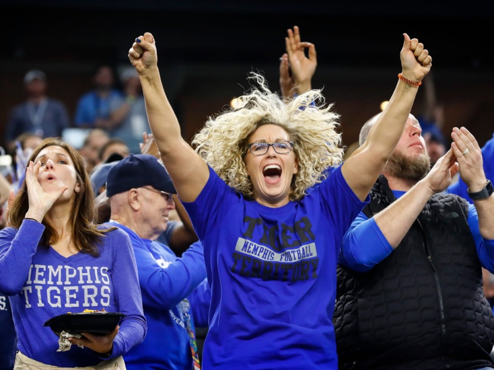 <strong>Memphis fans celebrate a touchdown during action against Penn State at the Cotton Bowl on Dec. 28, 2019, at AT&amp;T Stadium in Arlington, Texas.</strong> (Mark Weber/Daily Memphian)