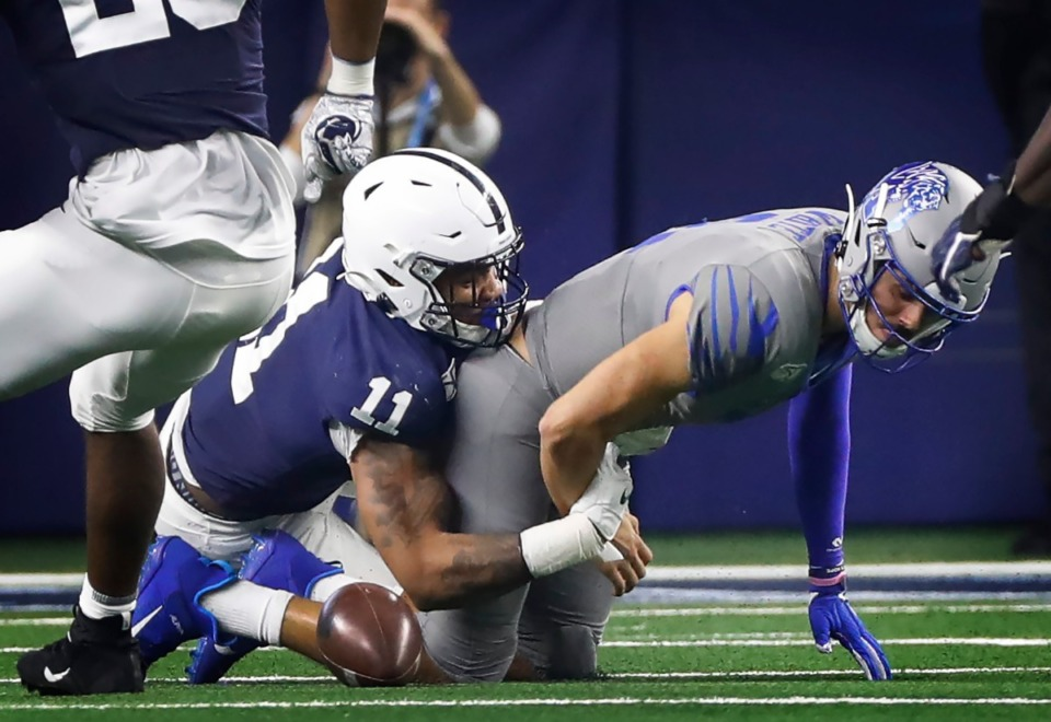 <strong>University of Memphis quarterback Brady White (right) fumbles the ball while being sacked by Penn State defender Micah Parsons (left) during action at the Cotton Bowl on Dec. 28, 2019, at AT&amp;T Stadium in Arlington, Texas.</strong> (Mark Weber/Daily Memphian)