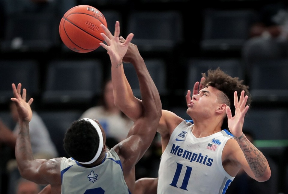 <strong>University of Memphis guard Laster Quinones (11) blocks a shot by the Privateers' Troy Green during the Tigers' game on Dec. 28, 2019, against New Orleans at the FedExForum.</strong> (Jim Weber/Daily Memphian)