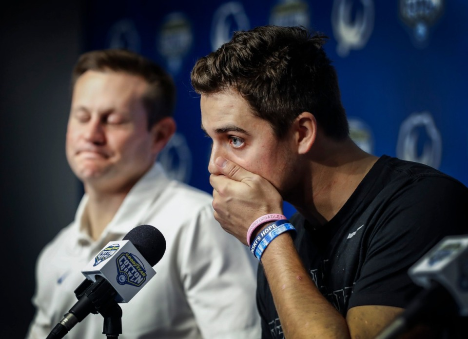 <strong>University of Memphis quarterback Brady White (right) speaks during a post-game press conference after a 53-39 loss to Penn State at the Cotton Bowl on Dec. 28, 2019, at AT&amp;T Stadium in Arlington, Texas.</strong> (Mark Weber/Daily Memphian)