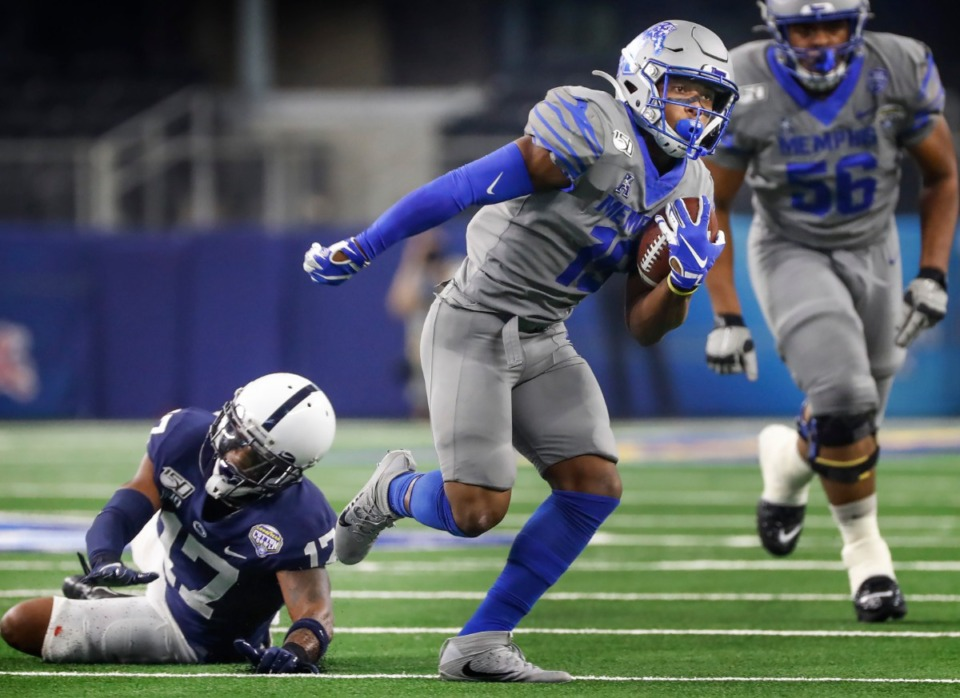 <strong>University of Memphis running back Kenneth Gainwell (right) runs for a first down past Penn State defender Garrett Taylor (left) during action at the Cotton Bowl on Dec. 28, 2019, at AT&amp;T Stadium in Arlington, Texas.</strong> (Mark Weber/Daily Memphian)
