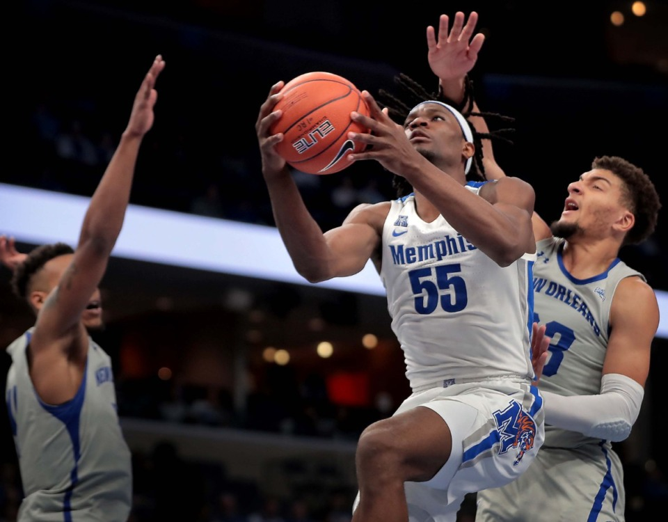 <strong>University of Memphis forward Precious Achiuwa shoots under pressure by the Privateers' Ahren Freeman during the Tigers' game on Dec. 28, 2019, against New Orleans at the FedExForum.</strong> (Jim Weber/Daily Memphian)