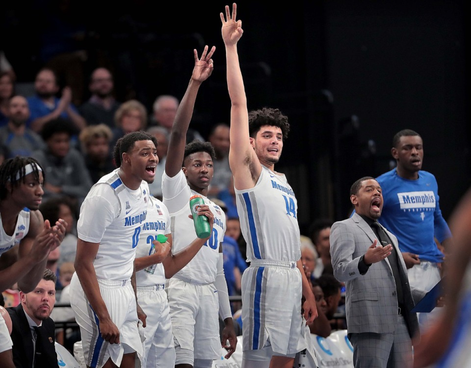 <strong>University of Memphis players celebrate a three point shot against the Privateers during the Tigers' game on Dec. 28, 2019, against New Orleans at the FedExForum.</strong> (Jim Weber/Daily Memphian)
