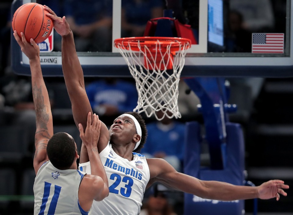 <strong>University of Memphis forward Malcolm Dandridge (23) blocks a shot by the Privateers' Jahmel Myers during the Tigers' game on Dec. 28, 2019, against New Orleans at the FedExForum.</strong> (Jim Weber/Daily Memphian)