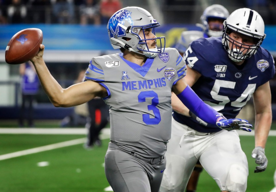 <strong>University of Memphis quarterback Brady White (left) looks to make a throw against Penn State defender Robert Windsor (right) during action at the Cotton Bowl on Dec. 28, 2019, at AT&amp;T Stadium in Arlington, Texas.</strong> (Mark Weber/Daily Memphian)