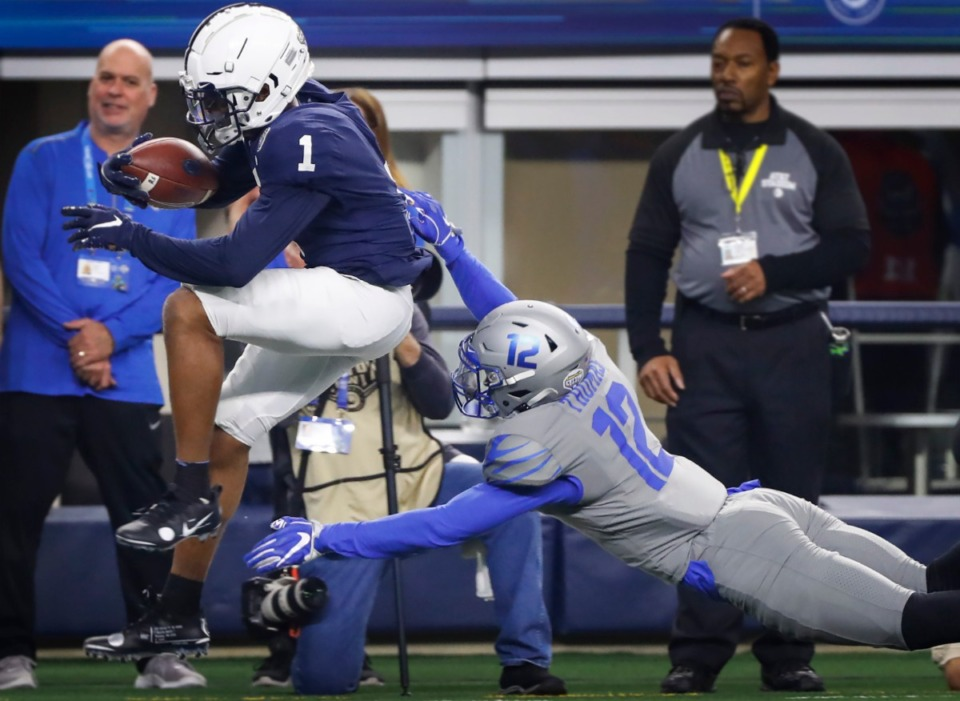 <strong>University of Memphis defender La'Andre Thomas (right) cannot bring down Penn State receiver KJ Hamler (left) during action at the Cotton Bowl on Dec. 28, 2019, at AT&amp;T Stadium in Arlington, Texas.</strong> (Mark Weber/Daily Memphian)