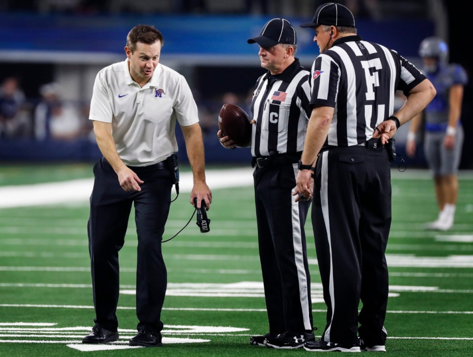 <strong>University of Memphis head coach Ryan Silverfield (left) makes his case to the officials during a break in action against Penn State at the Cotton Bowl on Dec. 28, 2019, at AT&amp;T Stadium in Arlington, Texas.</strong> (Mark Weber/Daily Memphian)