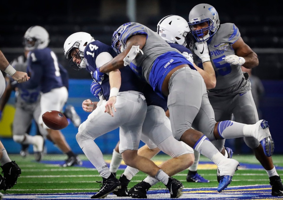 <strong>University of Memphis defender Morris Joseph (right) causes a fumble while sacking Penn State quarterback Sean Clifford (left) during action at the Cotton Bowl on Dec. 28, 2019, at AT&amp;T Stadium in Arlington, Texas.</strong> (Mark Weber/Daily Memphian)