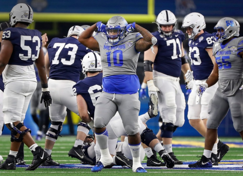 <strong>University of Memphis defender Morris Joseph (middle) celebrates a sack against Penn State during action at the Cotton Bowl on Dec. 28, 2019, at AT&amp;T Stadium in Arlington, Texas.</strong> (Mark Weber/Daily Memphian)