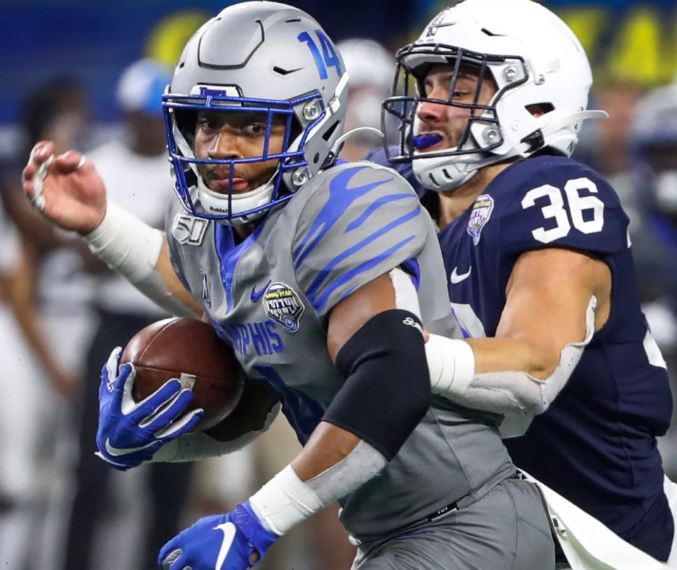 <strong>University of Memphis receiver Antonio Gibson (left) makes a first down catch against Penn State defender Jan Johnson (right) during action at the Cotton Bowl on Dec. 28, 2019, at AT&amp;T Stadium in Arlington, Texas.</strong> (Mark Weber/Daily Memphian)