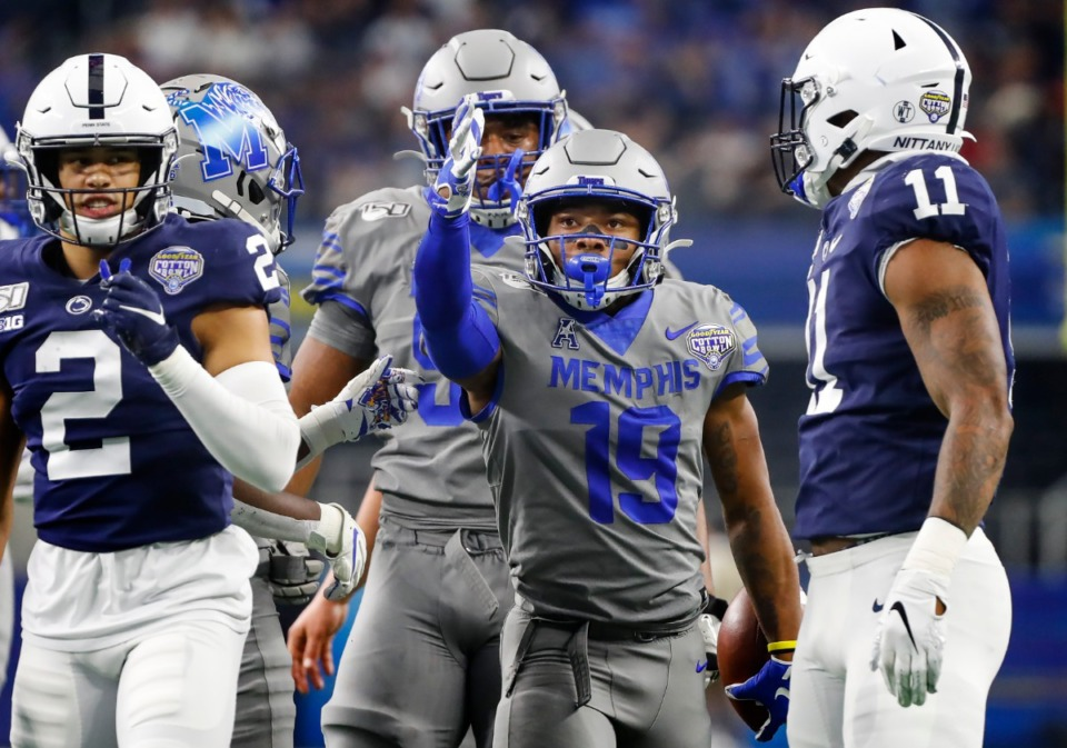 <strong>University of Memphis running back Kenneth Gainwell (middle) celebrates a first down against the Penn State defense during action at the Cotton Bowl on Dec. 28, 2019, at AT&amp;T Stadium in Arlington, Texas.</strong> (Mark Weber/Daily Memphian)