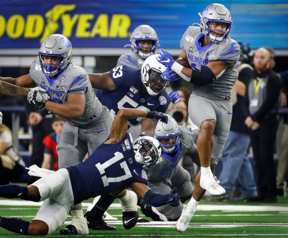 <strong>University of Memphis receiver Antonio Gibson (right) looks for positive yards against the Penn State defense during action at the Cotton Bowl on Dec. 28, 2019, at AT&amp;T Stadium in Arlington, Texas.</strong> (Mark Weber/Daily Memphian)