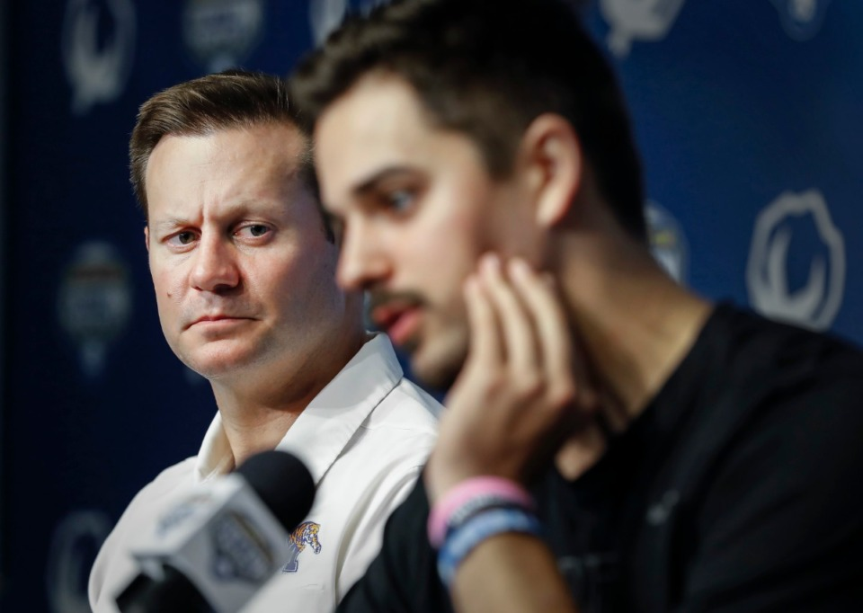 <strong>University of Memphis head coach Ryan Silverfield (left) listens to quarterback Brady White (right) during a post-game press conference after a 53-39 loss to Penn State at the Cotton Bowl on Dec. 28, 2019, at AT&amp;T Stadium in Arlington, Texas.</strong> (Mark Weber/Daily Memphian)