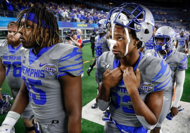 <strong>Dejected University of Memphis teammates Kameron Wilson (left) and Jashon Watkins-Perkins (right) walk of the field after losing to Penn State 53-39 in the Cotton Bowl Saturday, Dec. 28, 2019 at AT&amp;T Stadium in Arlington, Texas.</strong> (Mark Weber/Daily Memphian)