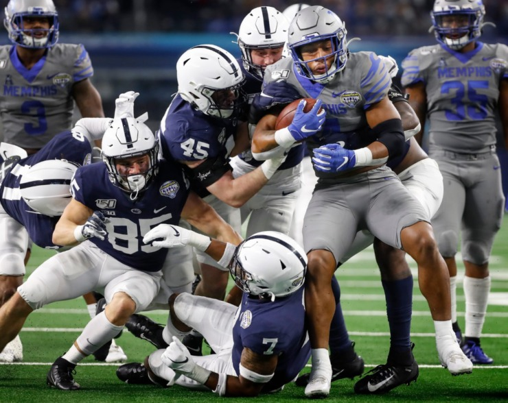 <strong>University of Memphis kick returner Antonio Gibson (right) is gang tackled by the Penn State defense during action at the Cotton Bowl Saturday, Dec. 28, 2019 at AT&amp;T Stadium in Arlington, Texas.</strong> (Mark Weber/Daily Memphian)