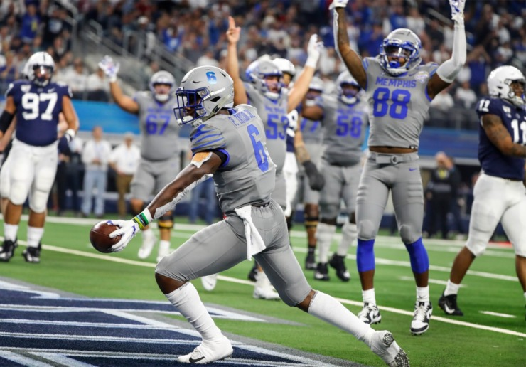 <strong>University of Memphis running back Patrick Taylor Jr. (middle) celebrates a touchdown against Penn State during action at the Cotton Bowl Saturday, Dec. 28, 2019 at AT&amp;T Stadium in Arlington, Texas.</strong> (Mark Weber/Daily Memphian)