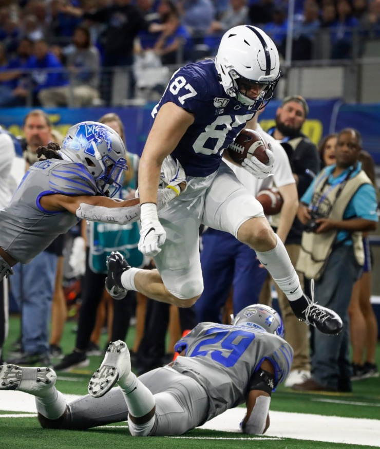 <strong>University of Memphis defenders Chris Claybrooks (left) and Carlito Gonzalez (bottom) try to bring down Penn State tight end Pat Freiermuth (middle) during action at the Cotton Bowl Saturday, Dec. 28, 2019 at AT&amp;T Stadium in Arlington, Texas.</strong> (Mark Weber/Daily Memphian)