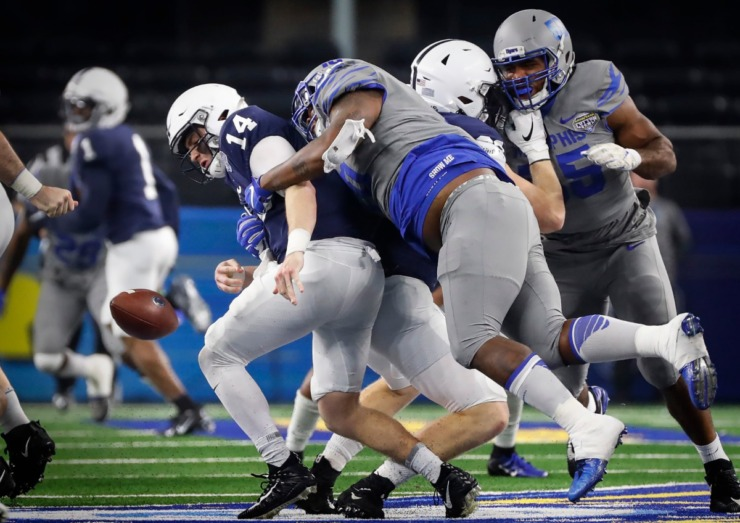 <strong>University of Memphis defender Morris Joseph (right) causes a fumble while sacking Penn State quarterback Sean Clifford (left) during action at the Cotton Bowl Saturday, Dec. 28, 2019 at AT&amp;T Stadium in Arlington, Texas.</strong> (Mark Weber/Daily Memphian)