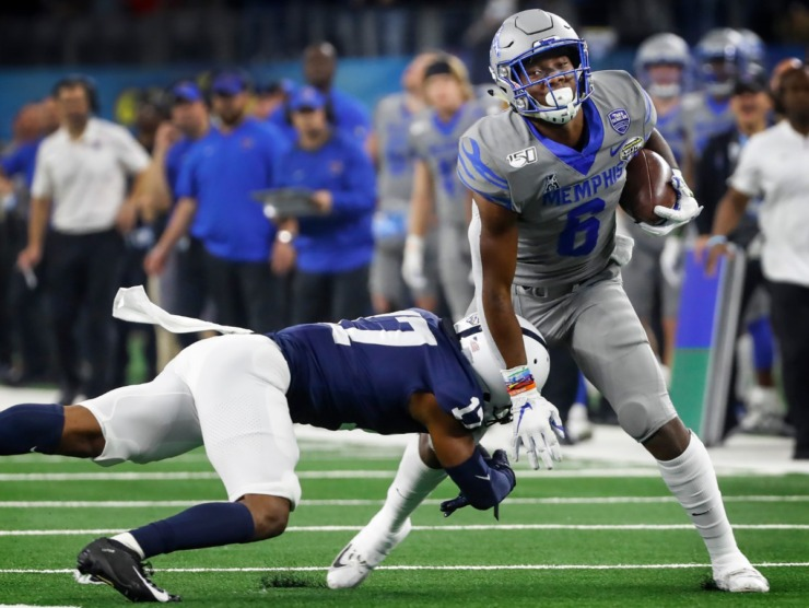 <strong>University of Memphis running back Patrick Taylor Jr. (right) fights for a first down against Penn State defender Garrett Taylor (left) during action at the Cotton Bowl Saturday, Dec. 28, 2019 at AT&amp;T Stadium in Arlington, Texas.</strong> (Mark Weber/Daily Memphian)