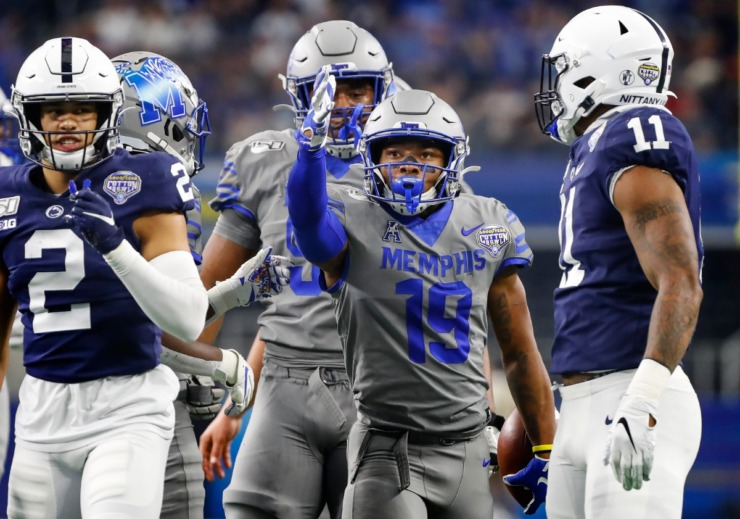 <strong>University of Memphis running back Kenneth Gainwell (middle) celebrates a first down against the Penn State defense during action at the Cotton Bowl Saturday, Dec. 28, 2019 at AT&amp;T Stadium in Arlington, Texas.</strong> (Mark Weber/Daily Memphian)