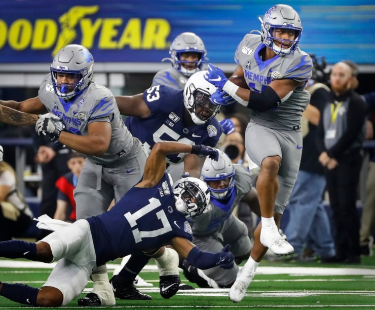 <strong>University of Memphis receiver Antonio Gibson (right) looks for positive yards against the Penn State defense during action at the Cotton Bowl Saturday, Dec. 28, 2019 at AT&amp;T Stadium in Arlington, Texas.</strong> (Mark Weber/Daily Memphian)