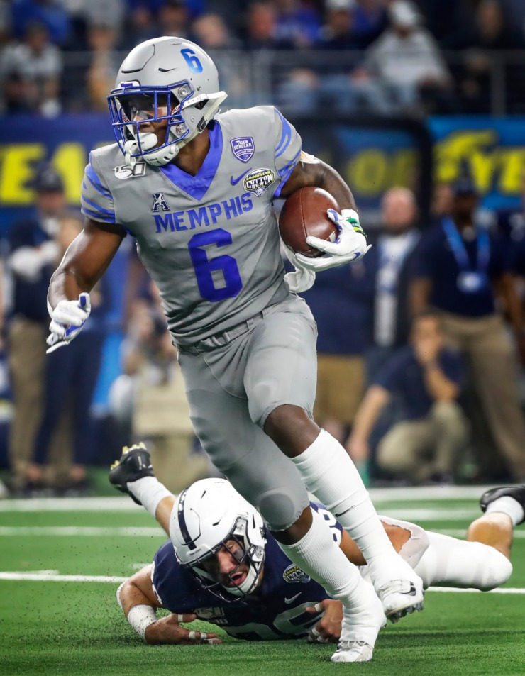 <strong>University of Memphis running back Patrick Taylor Jr. (top) scrambles past Penn State defender Jan Johnson (bottom) for a touchdown during action at the Cotton Bowl Saturday, Dec. 28, 2019 at AT&amp;T Stadium in Arlington, Texas.</strong> (Mark Weber/Daily Memphian)