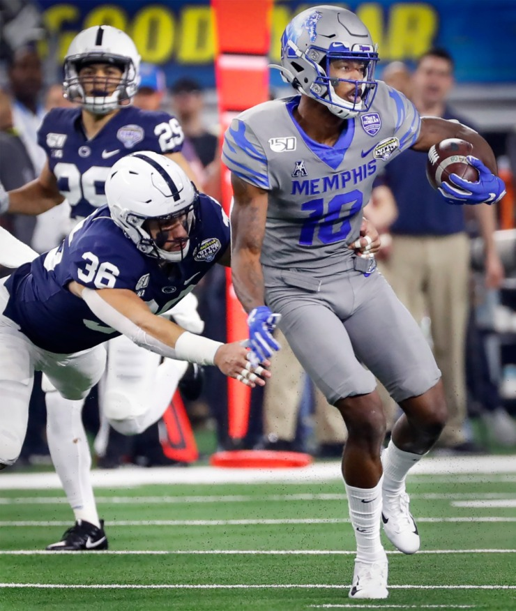 <strong>University of Memphis receiver Damonte Coxie (right) makes a first down catch in front of Penn State defender Jan Johnson (left) during action at the Cotton Bowl Saturday, Dec. 28, 2019 at AT&amp;T Stadium in Arlington, Texas.</strong> (Mark Weber/Daily Memphian)