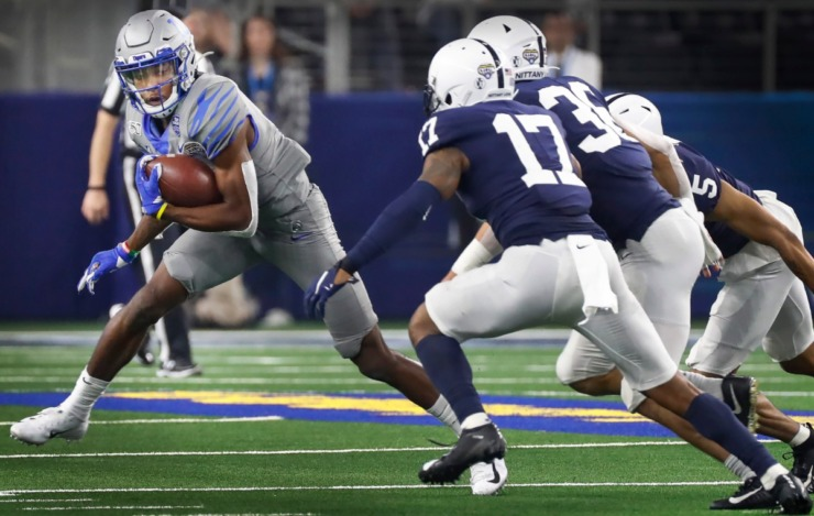 <strong>University of Memphis receiver Damonte Coxie (left) looks for positive yards agains the Penn State defense during action at the Cotton Bowl Saturday, Dec. 28, 2019 at AT&amp;T Stadium in Arlington, Texas.</strong> (Mark Weber/Daily Memphian)