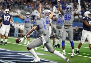 <strong>Memphis running back Patrick Taylor Jr. (middle) celebrates a touchdown against Penn State during action at the Cotton Bowl Saturday, Dec. 28, 2019 at AT&amp;T Stadium in Arlington, Texas.</strong> (Mark Weber/Daily Memphian)