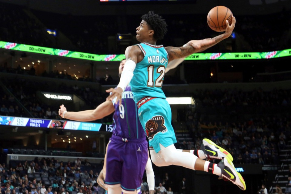 <strong>Memphis Grizzlies guard Ja Morant (12) goes up to shoot while defended by Charlotte Hornets center Willie Hernangomez (9) in the second half of an NBA basketball game Sun., Dec. 29, 2019, at FedExForum.</strong> (Karen Pulfer Focht/AP)